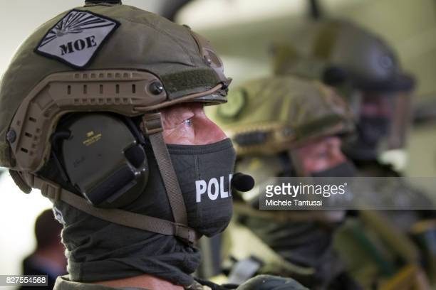 Officiers of the Police special forces or GSG9 stand during the opening of the new Headquarters on August 8 2017 in Berlin Starting from August all...