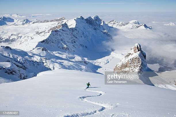 off-piste skier in powder snow - european alps stock photos and pictures