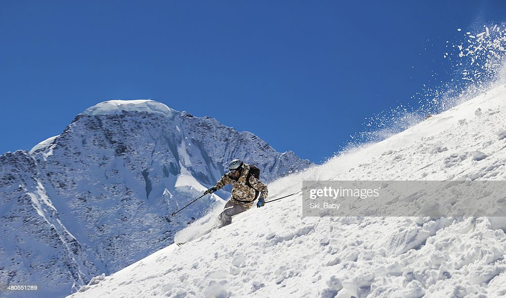 Off-piste Skiing at high speed : Stock Photo
