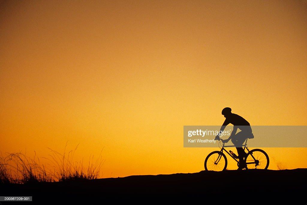 Off-road biker at sunset, Discovery Park, Seattle, Washington, USA : Stock Photo