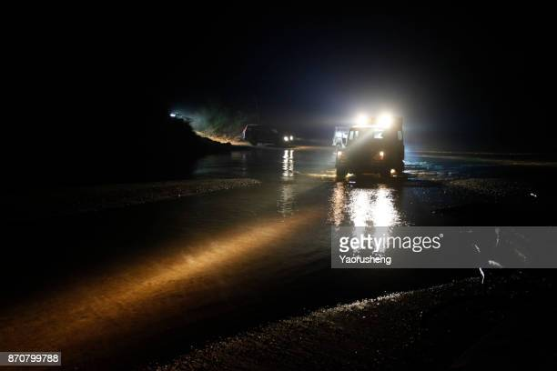 off-road suv driving in the river,extremly explore tour in forest - night safari stock pictures, royalty-free photos & images