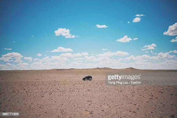 off-road vehicle at gobi desert against sky - gobi desert stock pictures, royalty-free photos & images