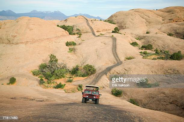 off-road vehicle driving on rock formation - 岩壁 ストックフォトと画像