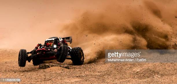 off-road vehicle during race on dirt field - dust stock pictures, royalty-free photos & images