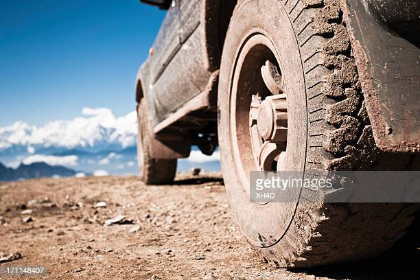 off-road vehicle on mountain peak