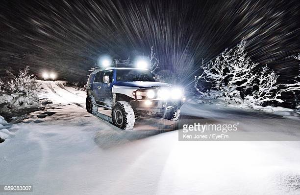 Off-Road Vehicle On Snow Covered Field At Night