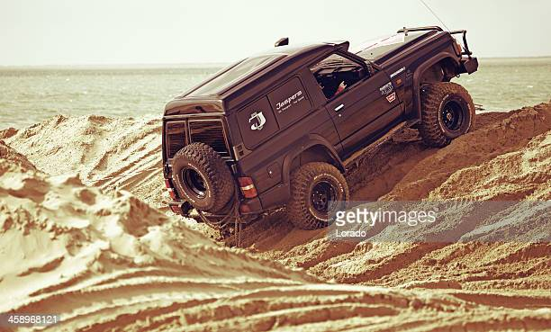 off-road vehicle riding on sand