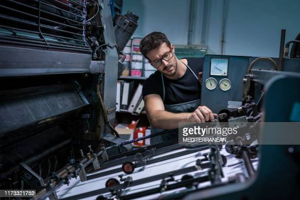 offset 2 colors printer man at work - graphic print stock pictures, royalty-free photos & images