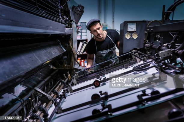 offset 2 colors printer man at work - printing plant stock pictures, royalty-free photos & images