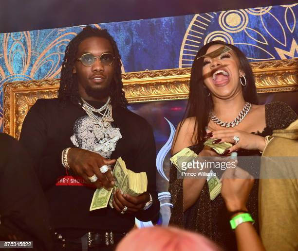 Offset and Cardi B attend DJ Holiday Birthday Celebration at Amora Lounge on November 16 2017 in Atlanta Georgia