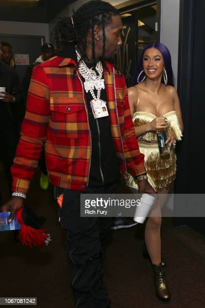 Offset and Cardi B walk backstage during 1027 KIIS FM's Jingle Ball 2018 Presented by Capital One at The Forum on November 30 2018 in Inglewood...