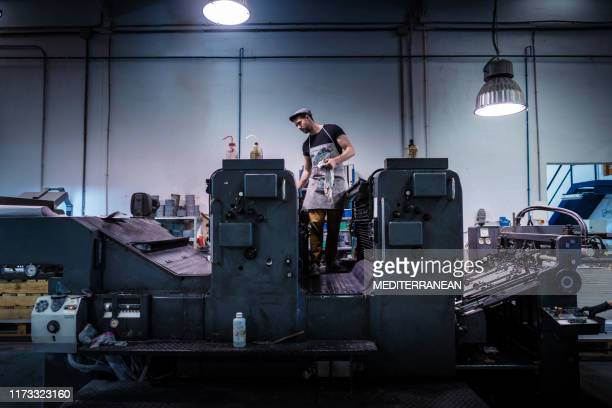 offset printer man with 2 colors printer - graphic print stock pictures, royalty-free photos & images