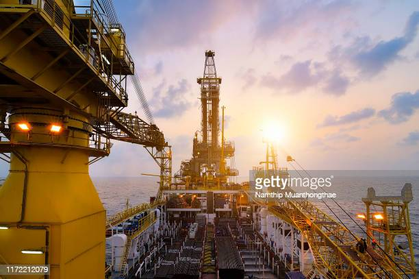 offshore drilling oil rig for producing oil and gas in the petroleum industry - hydrocarbon stock pictures, royalty-free photos & images