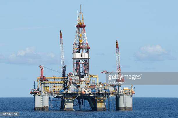 Offshore drilling platform with helicopter. Oil rig