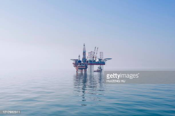 offshore oil rig in east china sea - oil rig stock pictures, royalty-free photos & images