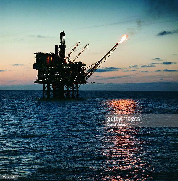 off-shore oil rig - oil industry stock pictures, royalty-free photos & images