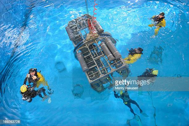 offshore oil workers in simulated helicopter, being trained in sea ditching survival in pool facility - rescue stock pictures, royalty-free photos & images