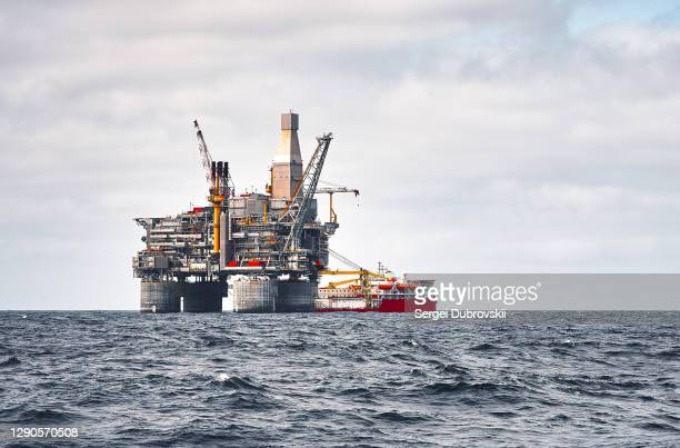 offshore platform and supply ship, sea wave blue clear sky - sea of okhotsk stock pictures, royalty-free photos & images