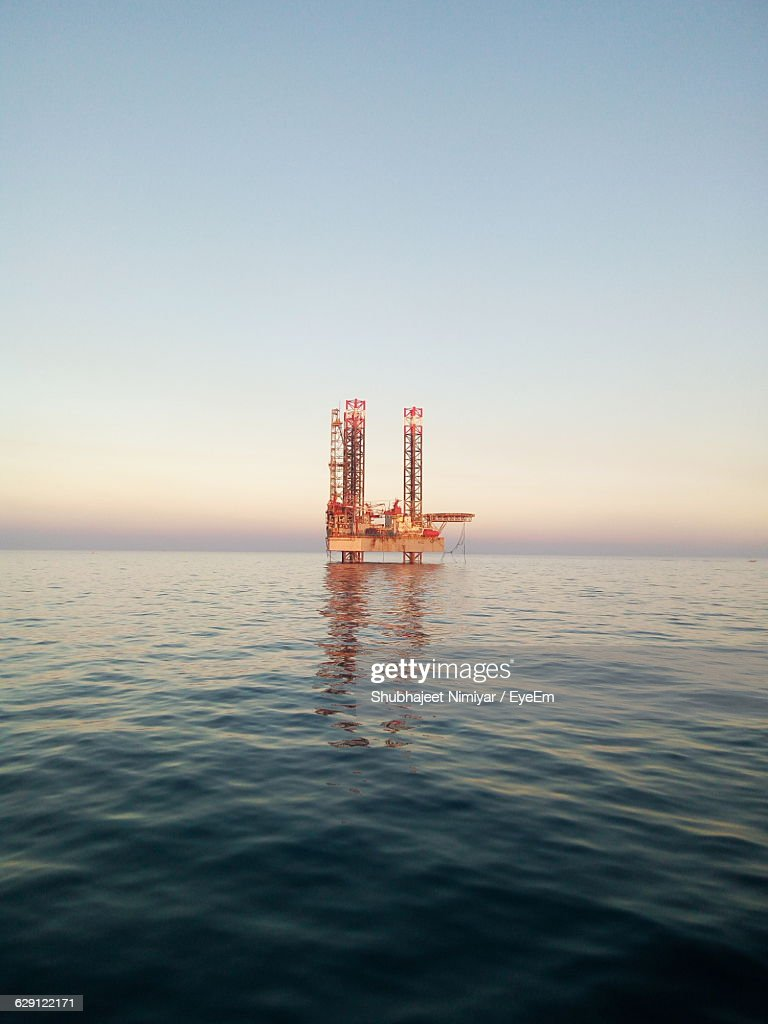 Offshore Platform In Sea Against Clear Sky During Sunset : Stock Photo