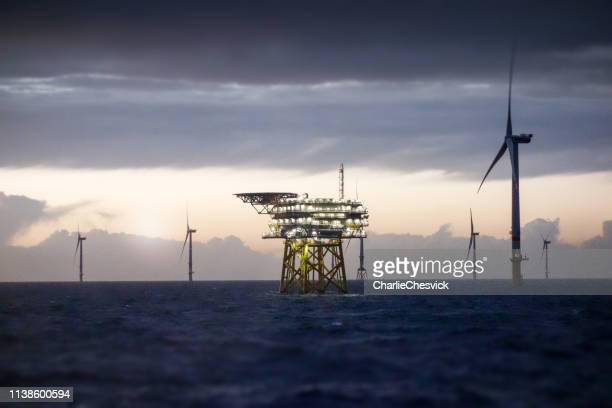 offshore platform - substation and wind farm in sunset - sea stock pictures, royalty-free photos & images