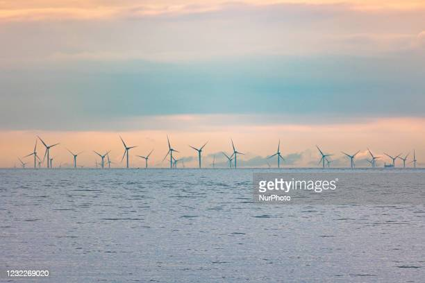 Off-shore wind park of windmills generating green renewable electric energy 20 kilometers away from the Dutch coast between the Netherlands and the...