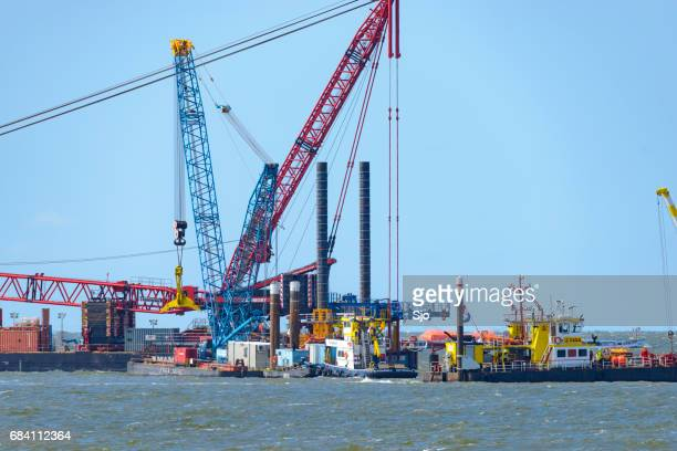 offshore wind turbine construction - marine engineering stock photos and pictures