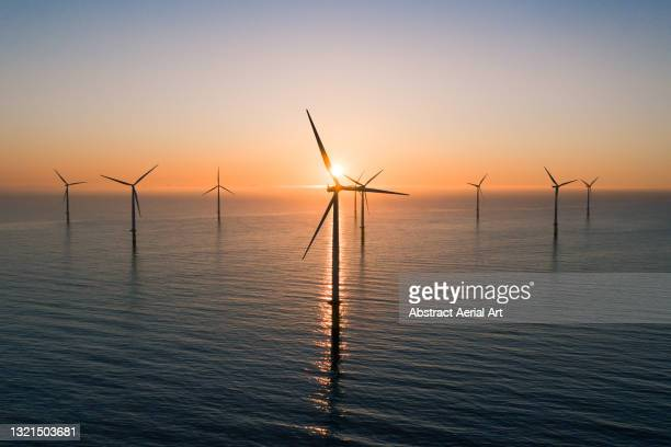offshore wind turbines at sunrise seen from an aerial point of view, redcar, england, united kingdom - wind stock pictures, royalty-free photos & images