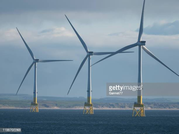 offshore wind turbines near aberdeen, scotland - windmill stock pictures, royalty-free photos & images