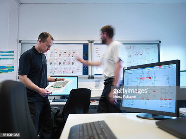 Offshore windfarm engineers in office