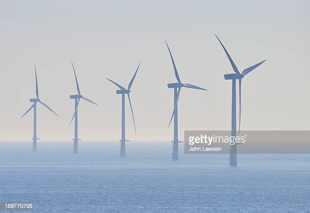Offshore windmills in the North Sea. Part of a wind turbine farm that generates green electricity. These are situated between England and The...