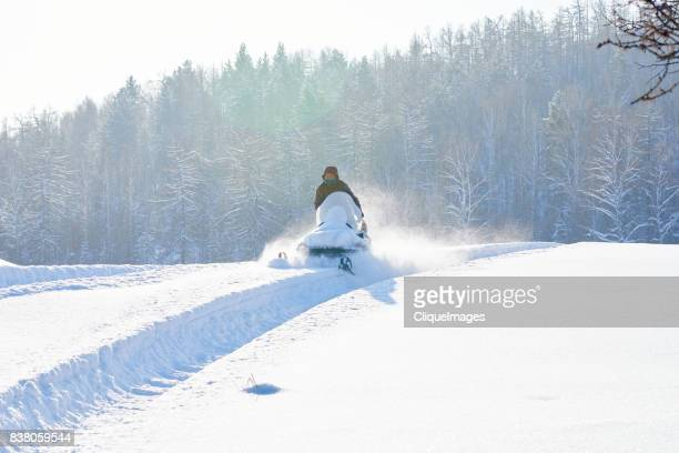 off-trail snowmobile riding - cliqueimages stock pictures, royalty-free photos & images