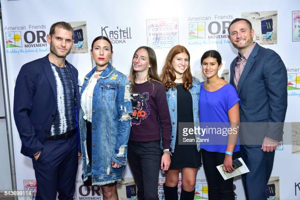 Ofir Fisher Abbi Halpern Guest Guest Guest and Jeremy Halpern attend OR Movement Tahor Group Present NYFW Desert Flower by Matan Shaked Keren Wolf...
