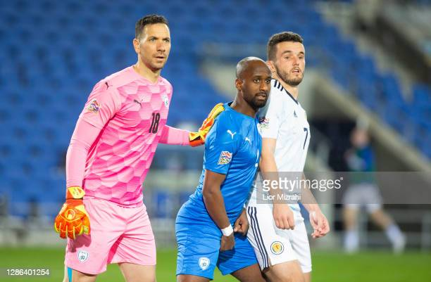 Ofir Marciano and Eli Dasa of Israel challenge John McGinn of Scotland during the UEFA Nations League group stage match between Israel and Scotland...