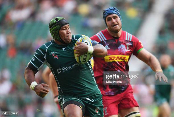 Ofisa Treviranus of London Irish breaks away from James Horwill of Harlequins as he scores their third try during the Aviva Premiership match between...