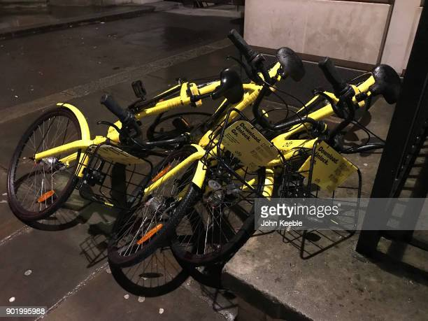 Ofo dockless bicycles lay fallen over on a street close by Fenchurch Street station on December 4 2018 in London England Ofo one of China's biggest...