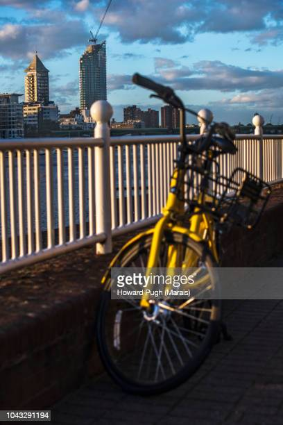 Ofo Yellow Bike. Autumn Coloured Cloud & Landscapes At Sunset