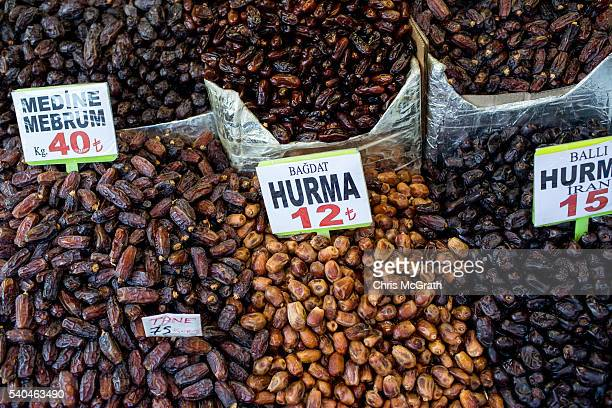 Often used to break fast piles of dates are seen for sale outside the Eyup Mosque during the holy month of Ramadan on June 15 2016 in Istanbul Turkey...