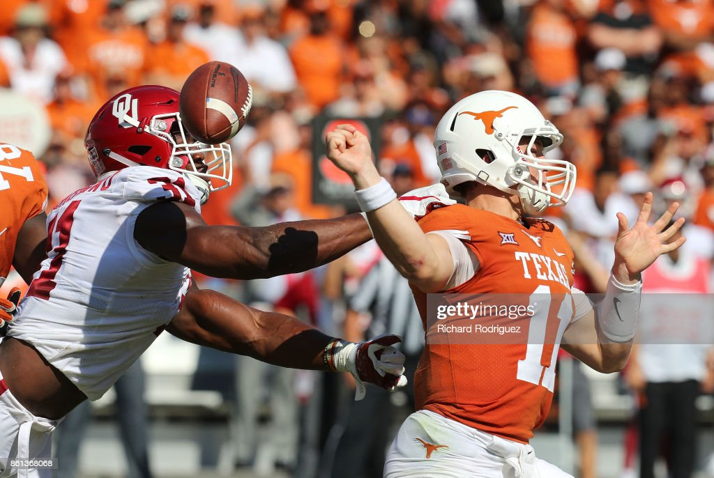 Ogbonnia Okoronkwo #31 of the Oklahoma Sooners forces a fumble by Sam Ehlinger #11 of the Texas Longhorns in the first quarter at Cotton Bowl on October 14, 2017 in Dallas, Texas.