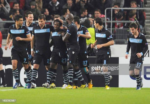 Ogenyi Onazi of Lazio celebrates his team's second goal with team mates during the UEFA Europa League round of sixteen first leg match between VfB...