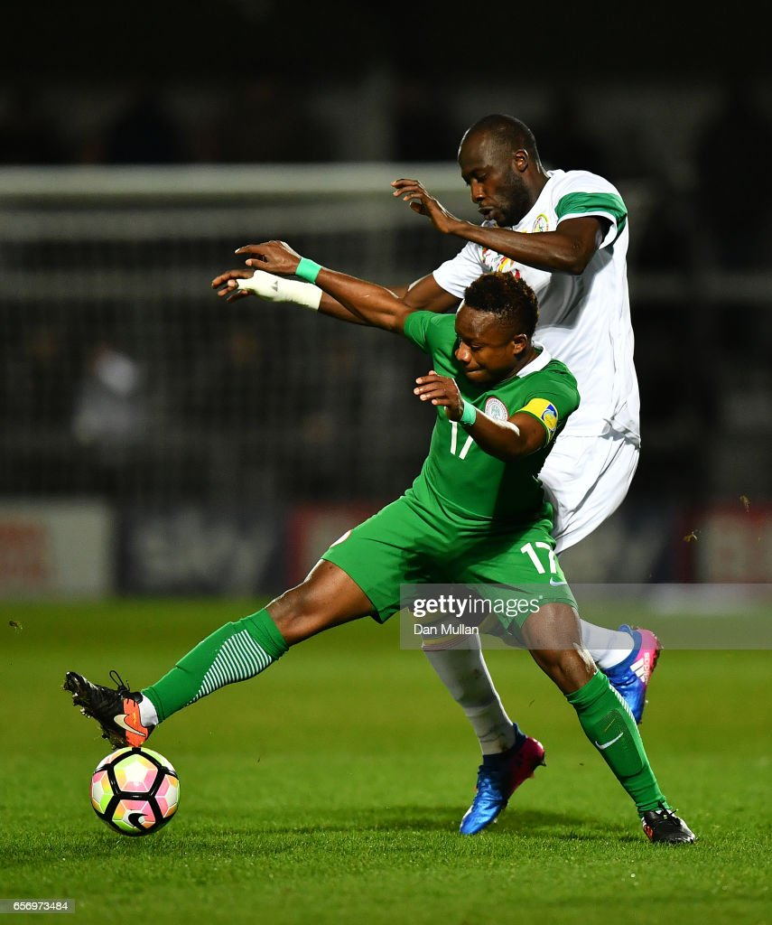 Ogenyi Onazi of Nigeria holds off Cheikh N'Doye of Senegal during the International Friendly match between Nigeria and Senegal at The Hive on March 23, 2017 in Barnet, England.