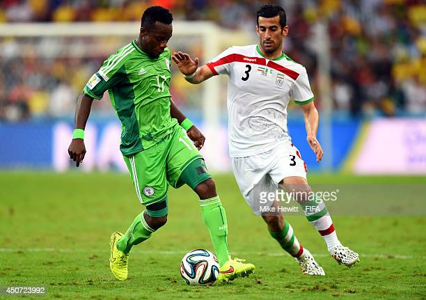 Ogenyi Onazi of Nigeria in action with Ehsan Haji Safi of Iran during the 2014 FIFA World Cup Brazil Group F match between Iran and Nigeria at Arena...