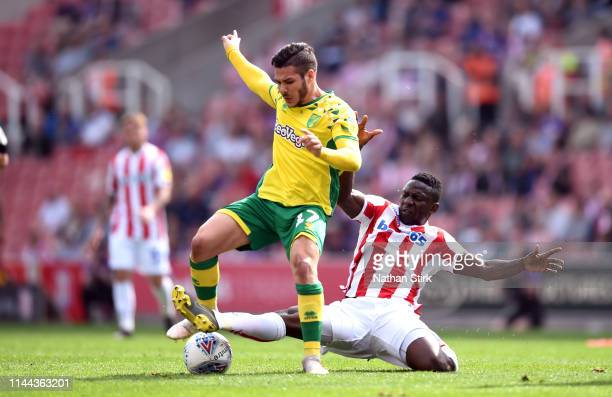Oghenekaro Etebo of Stoke City and Emiliano Buendía Stati of Norwich City in action during the Sky Bet Championship match between Stoke City and...