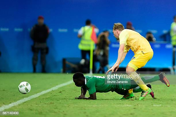 Oghenekaro Etebo player of Nigeria goes to ground after a challenge by Simon Tibbling player of Sweden during 2016 Summer Olympics match between...