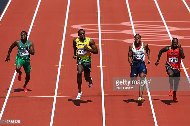 OghoOghene Egwero of Nigeria Usain Bolt of Jamaica James Dasaolu of Great Britain and Daniel Bailey of Antigua and Barbuda competes in the Men's 100m...