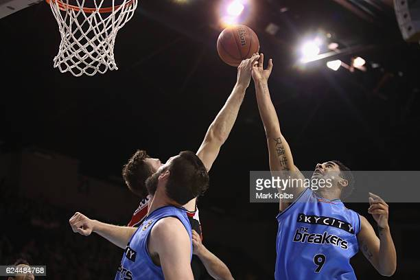 Ogilvy of the Hawks and Corey Webster of the Breakers compete for the ball during the round seven NBL match between the Illawarra Hawks and the New...