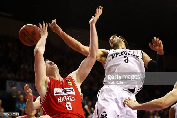 J Ogilvy of the Hawks and Josh Boone of Melbourne United compete for the ball during the round 10 NBL match between the Illawarra Hawks and the...