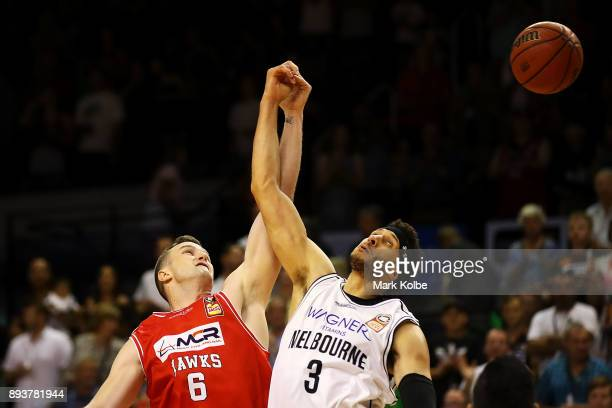 J Ogilvy of the Hawks and Josh Boone of Melbourne United tip off during the round 10 NBL match between the Illawarra Hawks and the Melbourne United...