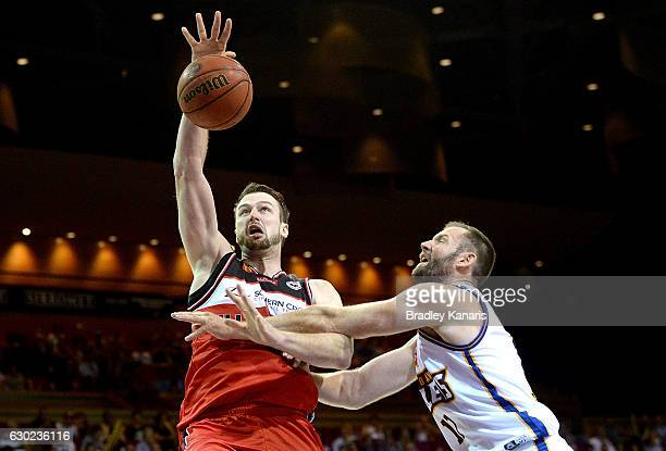Ogilvy of the Hawks takes on the defence of Anthony Petrie of the Bullets during the round 11 NBL match between the Brisbane Bullets and Illawarra...