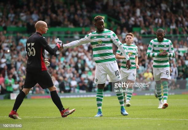 Ognjen Cancarevic of Alashkert congratulates Moussa Dembele of Celtic after he scores a penalty past him during the UEFA Champions League Qualifier...