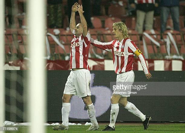 Ognjen Koroman of Belgrade celebrates with his teammate Dusan Basta after scoring 1-0 during the UEFA Cup group F match between Crvena Zvezda and...